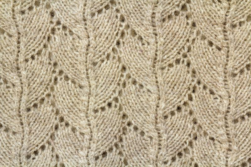 Background texture of beige pattern knitted fabric made of cotton or wool closeup royalty free stock photography