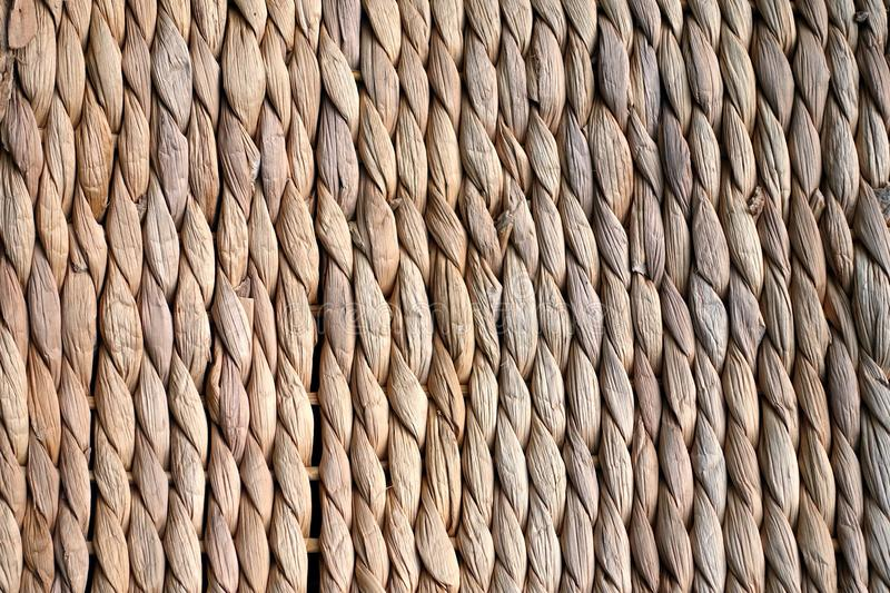 Background texture of beige or straw colored wicker or seagrass stock photography