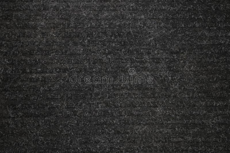 Background texture of black carpeting. Texture of the carpet for use as a background in further work royalty free stock photography