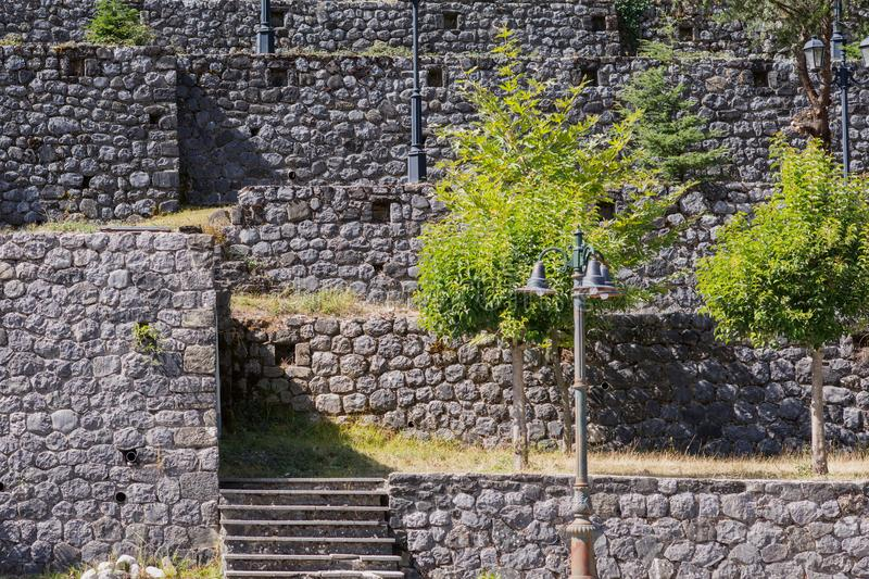 Background of a brick wall with trees and lanterns royalty free stock photos