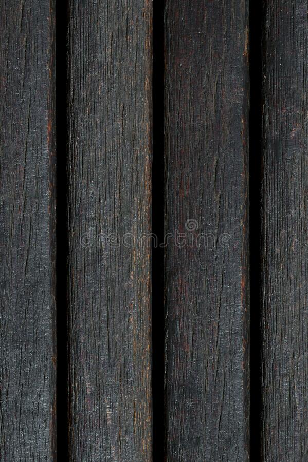 Background and texture of burnt vertical boards.  royalty free stock images