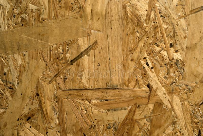 Background, texture - chipboard. Background, texture - surface of rough chipboard close-up stock image