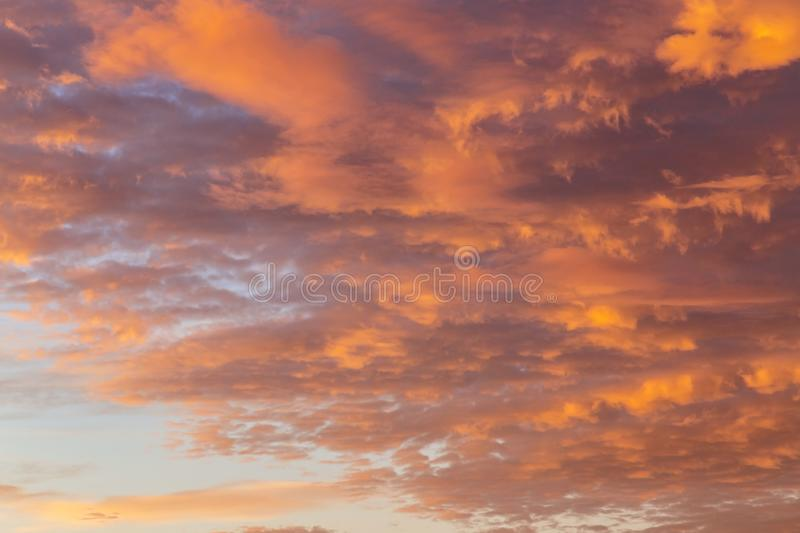 Background with the texture of clouds at sunset. Heavenly landscape. Beautiful morning sky painted in bright red and orange colors stock photos