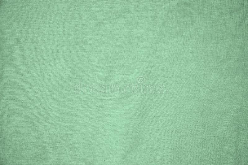 Background, texture, colored green fabric textile matt royalty free stock photos