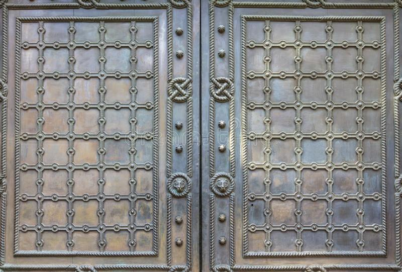 Background and texture details of the antique decoration of the entrance doors. Background and texture, details of the ancient decoration of the entrance doors stock photo