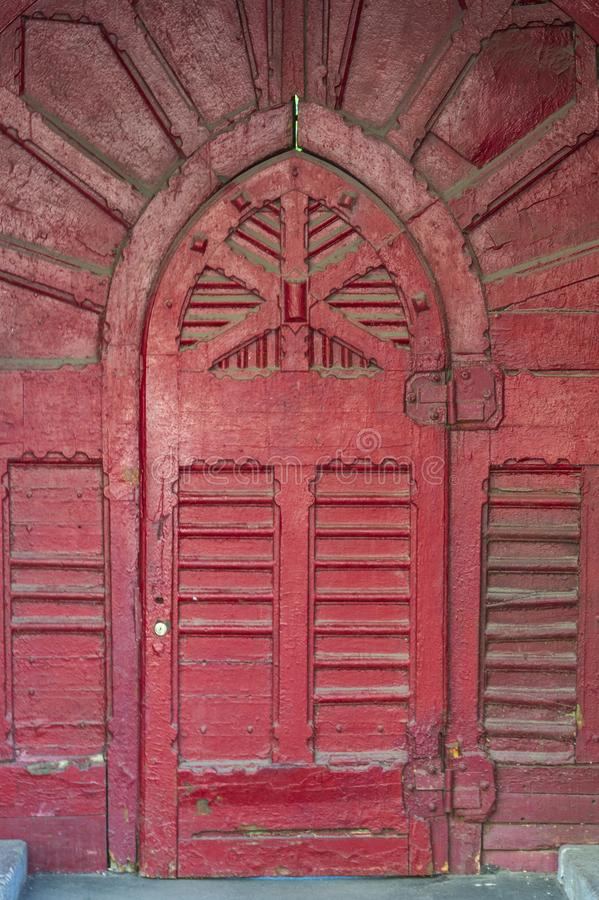 Background and texture details of the antique decoration of the entrance doors. Background and texture, details of the ancient decoration of the entrance doors royalty free stock photos
