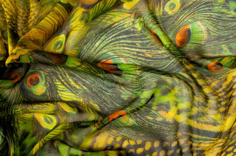 Background texture, drawing. Silk fabric. Light airy fabric. Green with peacock feathers. Yellow shade. Fabric cotton silk. Batiste mint green airy very light stock images
