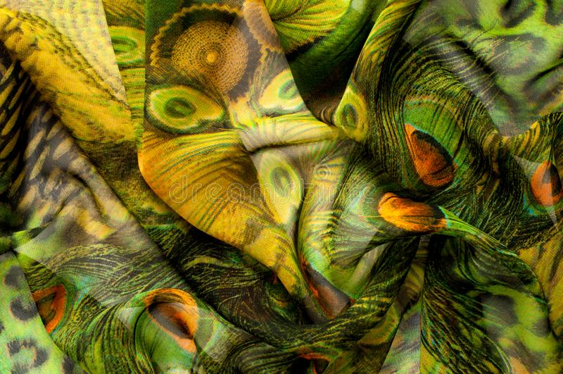 Background texture, drawing. Silk fabric. Light airy fabric. Green with peacock feathers. Yellow shade. Fabric cotton silk. Batiste mint green airy very light stock photo