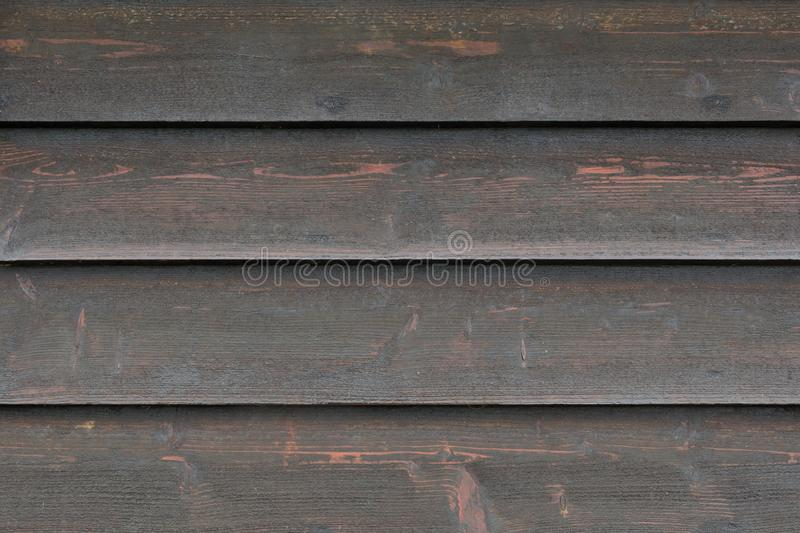 Background texture from faded black wooden boards, close up royalty free stock photography