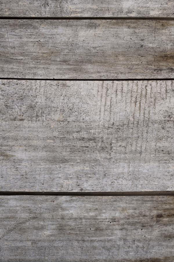 Background texture of the fence of the old gray boards. royalty free stock images