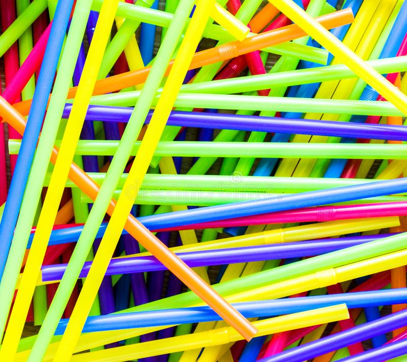 Background texture-jumbled pile of colorful plastic straws. Background texture full screen close up of a jumbled pile of colorful plastic flexible straws stock photos