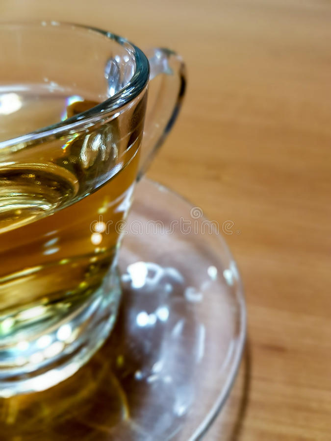 Background / texture A glass of hot Chinese tea on wooden table stock photos