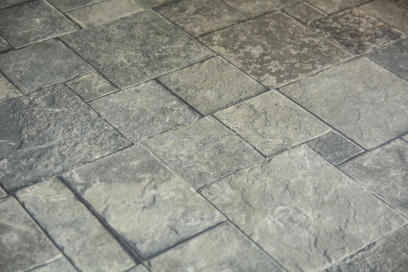 Background texture of gray tiled pavement city ground.  stock photo