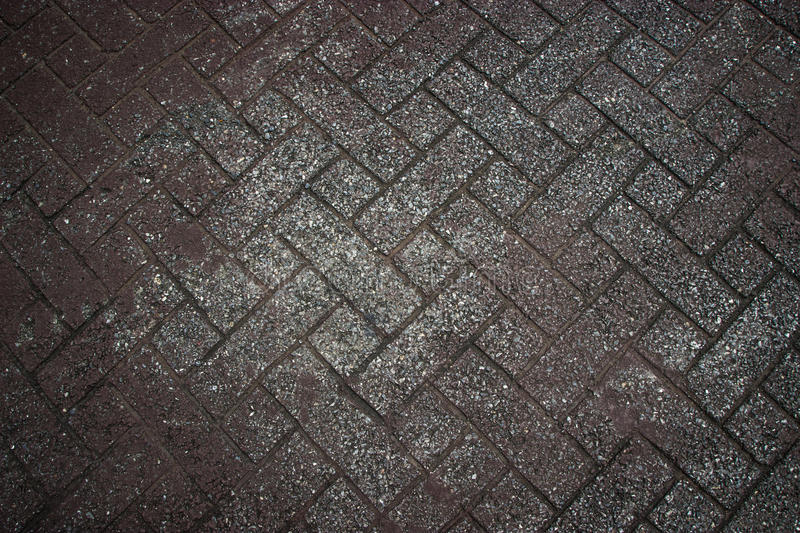 Background texture of gray tiled pavement city ground. Sidewalk concrete texture. Background texture of gray tiled pavement city ground royalty free stock images