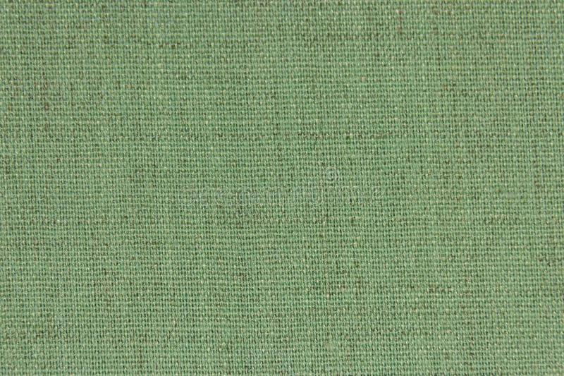 Background, texture, light green color wicker textile material, closeup. The structure of olive fabric with a natural royalty free stock photo