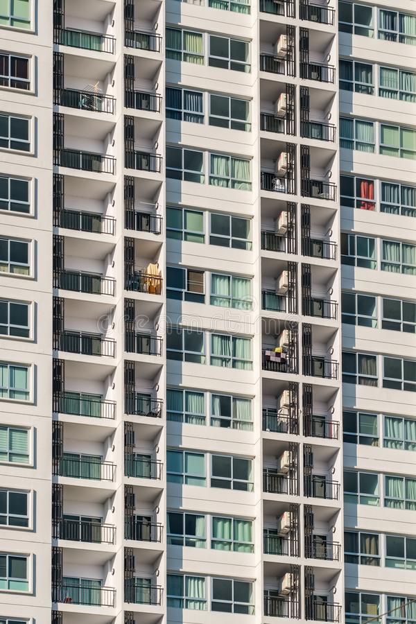 Background texture of many balconies on high-rise apartment building. Facade of a modern residential building. Background texture of many balconies on high-rise royalty free stock photos