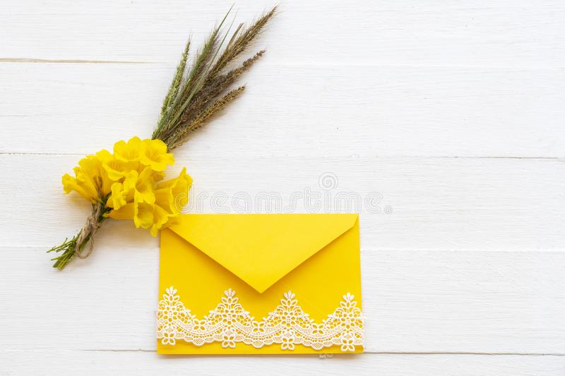 Background texture nature bouquet yellow flowers in yellow envelope decoraton flat lay postcard style stock photos
