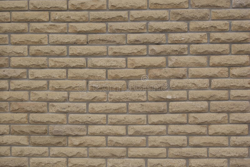 Background texture ocher brick wall Decorative royalty free stock image