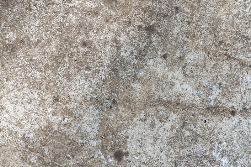 Background texture of an old concrete wall with cracks for mockup or design pattern in construction, food or industrial sample. Background texture of an old stock image