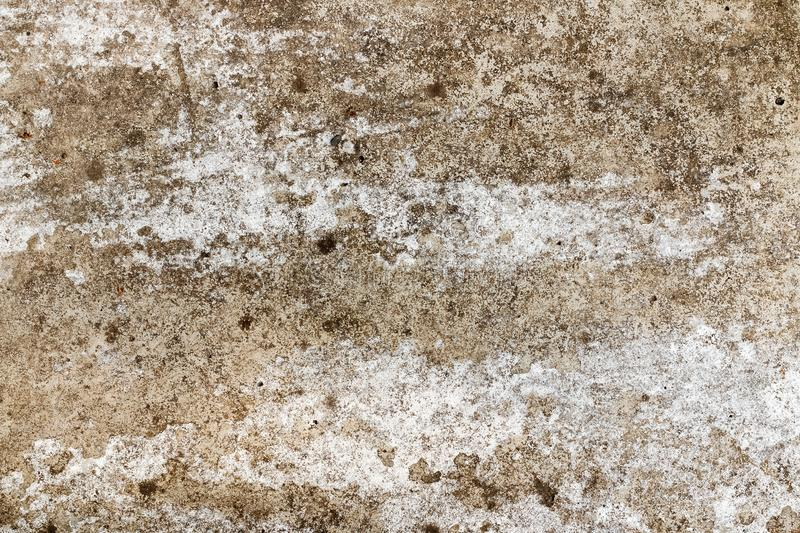 Background texture of an old concrete wall with cracks for mockup or design pattern in construction, food or industrial sample. Background texture of an old stock photo