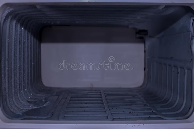 Background, texture of the old empty compartment of the refrigerator. royalty free stock image