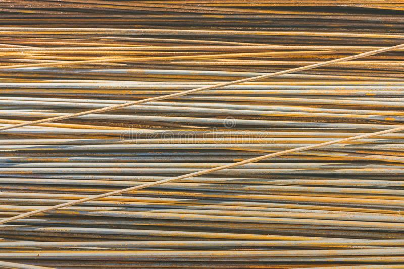 Background texture of old rusty steel bars construction materials stock photo