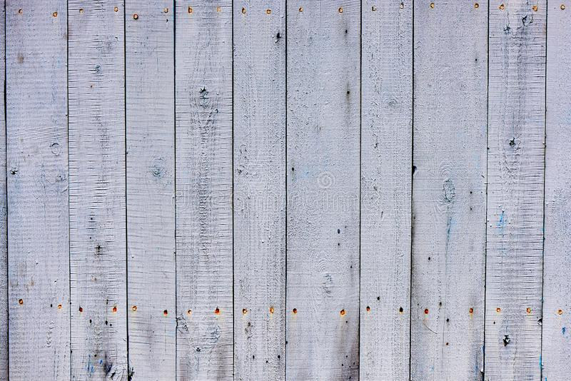 Background texture of the old wood covered with faded and cracked paint royalty free stock photography