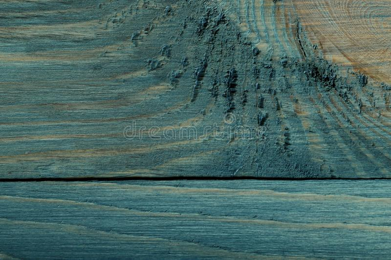 Background texture of painted wood. Top view on the texture of a blue-green wooden board. stock photos