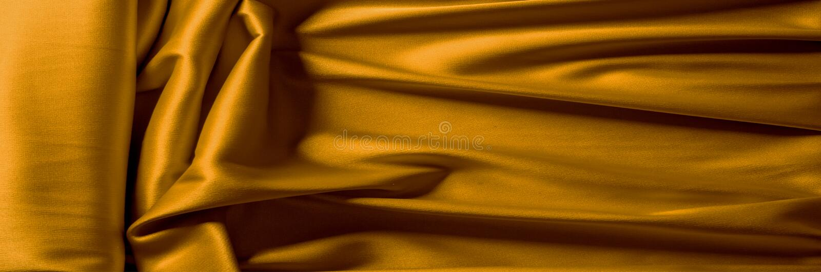Background texture pattern of dark yellow silk fabric. An unriva. Led example of excellent craftsmanship and fine craftsmanship brought by the Mughals in India royalty free stock photos