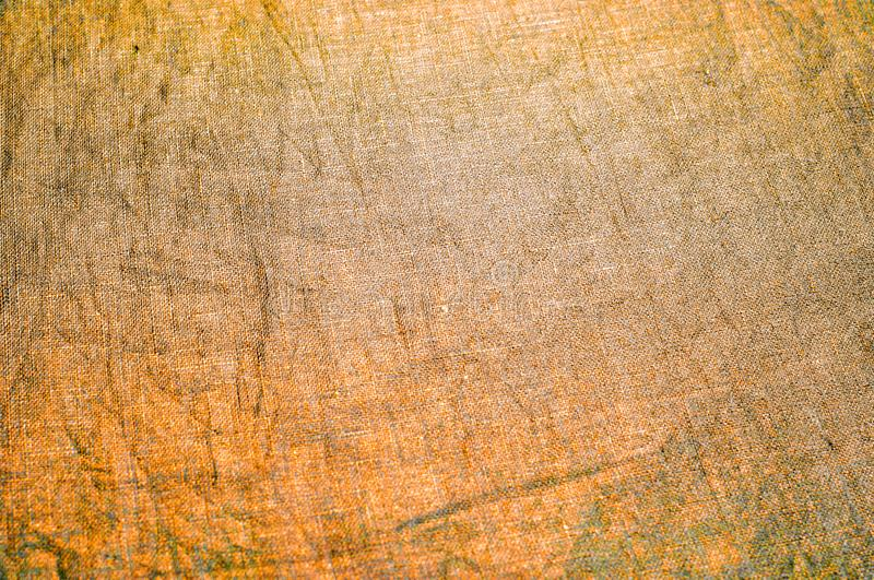 Background texture, pattern. Dense cotton fabric with gold color royalty free stock photo