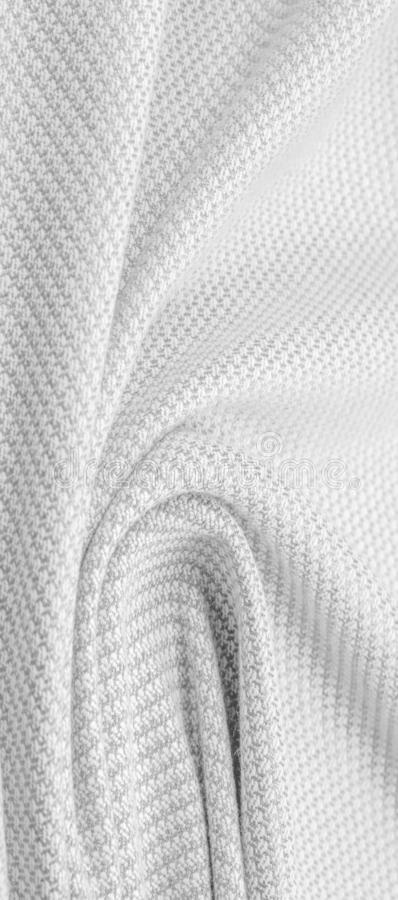 Background texture, pattern Fabric warm wool with stitched gray thread. Shake things with this white wool knit. Oversized, stocky. Knitwear is a modestly stock images
