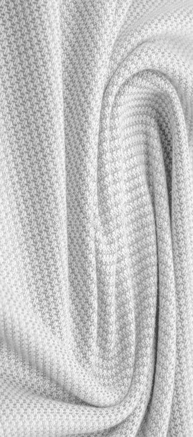 Background texture, pattern Fabric warm wool with stitched gray thread. Shake things with this white wool knit. Oversized, stocky. Knitwear is a modestly royalty free stock photography