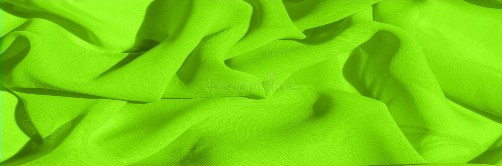 Background texture pattern. Lime Solid Silk Faile. Presenting th. Is high quality silk faille made specifically for Mood This gorgeous, medium-weight fabric stock photo