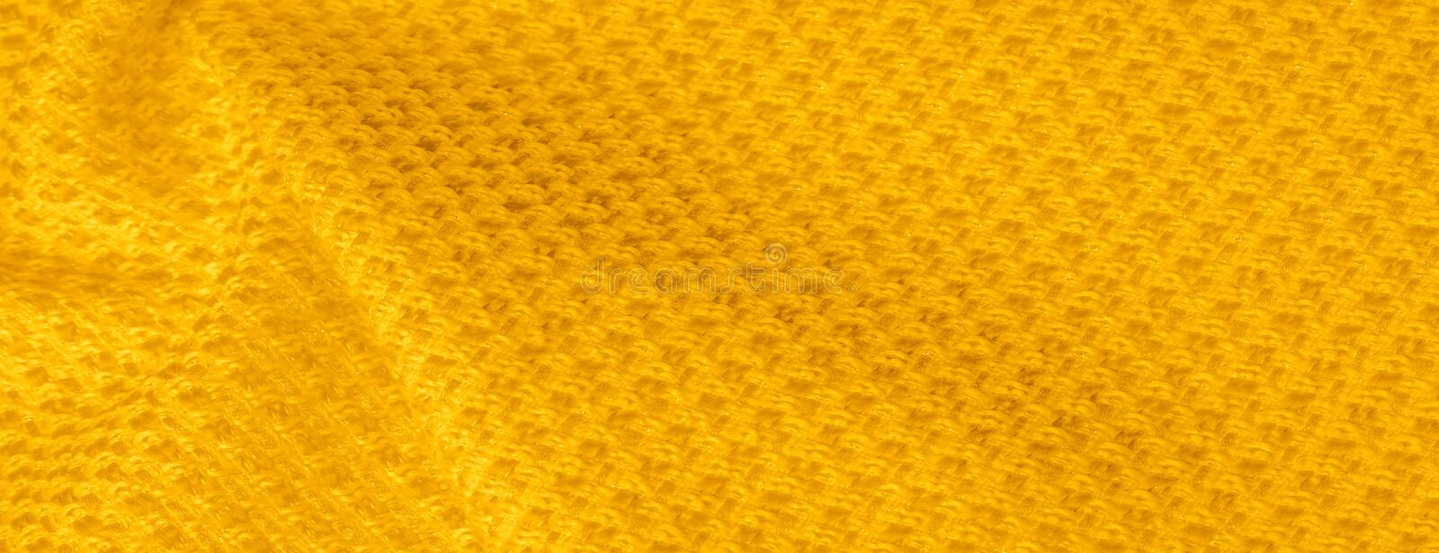 Background texture, pattern. Yellow fabric with metallic sequins. This beautiful lightweight sequined fabric has notes, sequined royalty free stock images