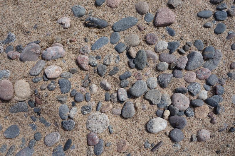 Background with pebbles and river sand on the shore. royalty free stock photos
