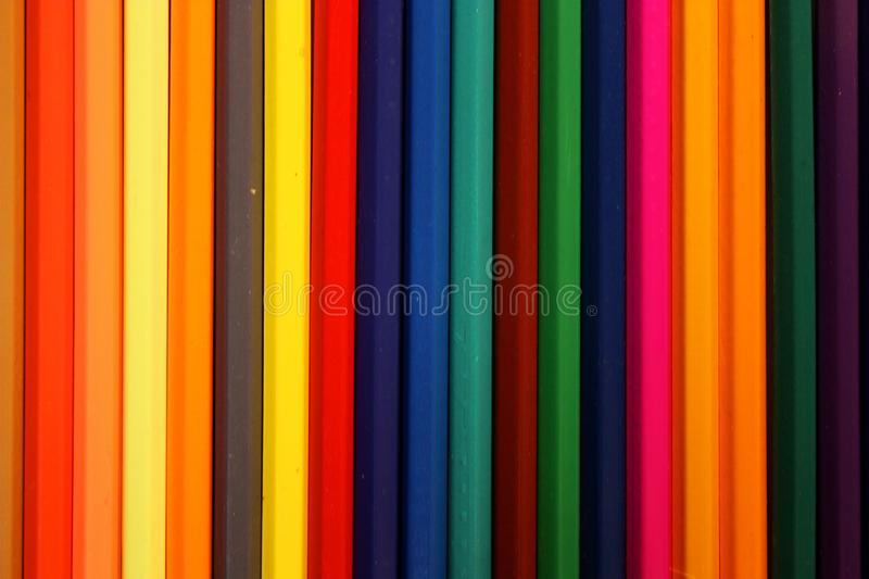 Colored pencils row background / texture stock photography
