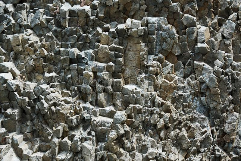 Background texture of the petrified volcanic lav. A on the coast royalty free stock photos
