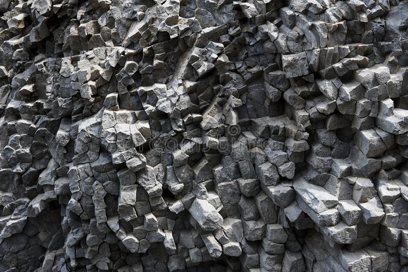 Background texture of the petrified volcanic lav. A on the coast stock photo