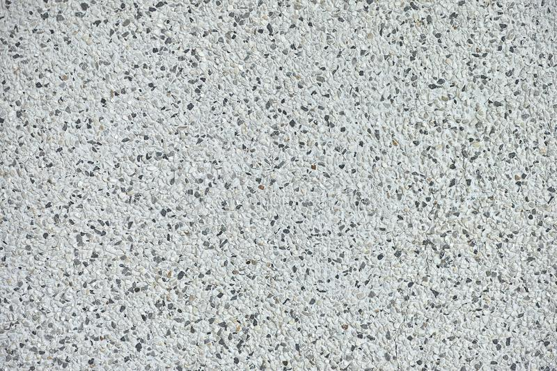 Background texture of polished stone showing the random distribution of constituent minerals forming a speckled pattern.  stock photos