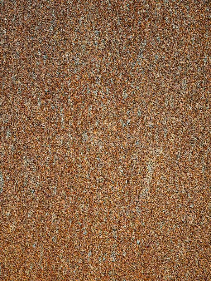 Background texture of rust. Metal sheet of red and orange color, covered with rust. stock image