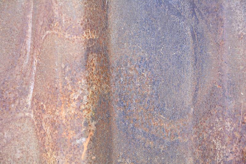 Background texture of rust. Metal sheet of red and orange color, covered with rust. Rough texture stock image