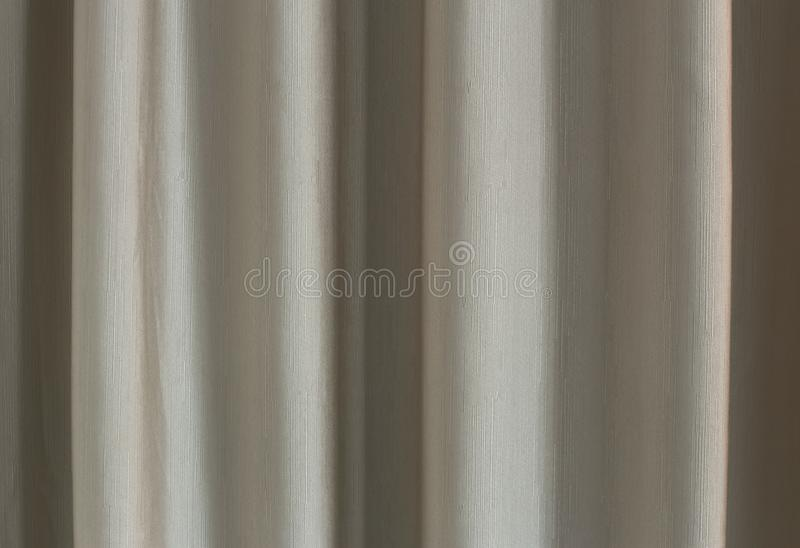 Background texture shade beige drapery lines. Background texture shade beige drapery vertical lines stock image