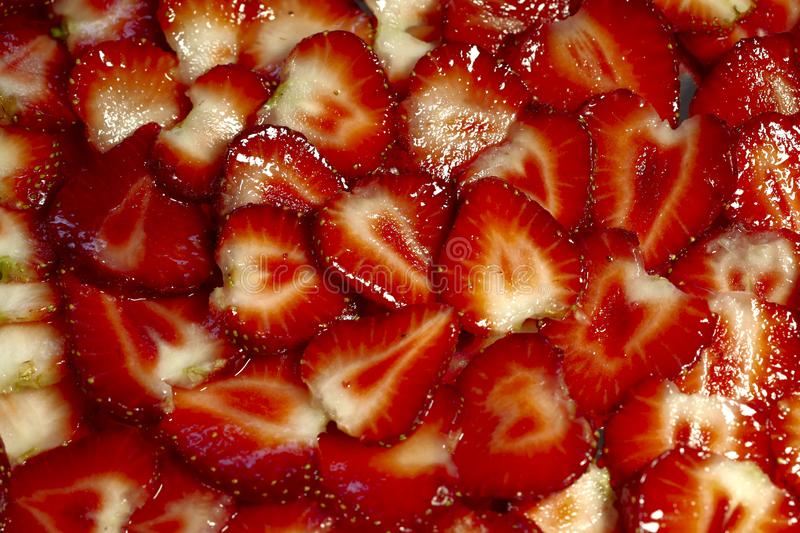 Background texture of slices of fresh strawberries. stock photos