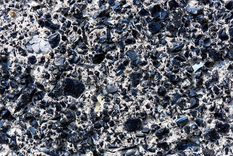 Background texture of solid surface with rocks close-up. Background texture of solid surface with rocks royalty free stock photos