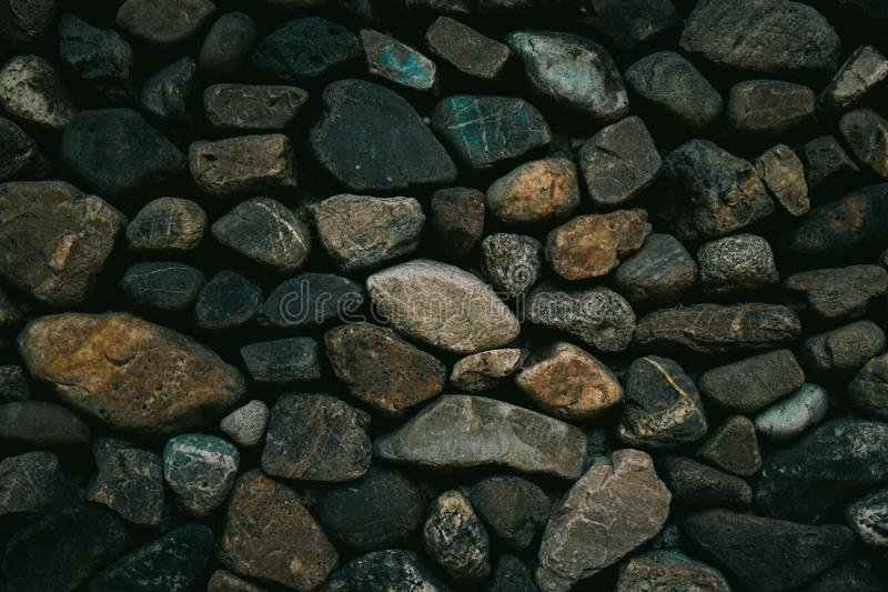Background texture of stone wall. Fragment of a wall from a chipped stone. royalty free stock image