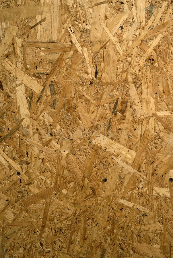 Background, texture - chipboard. Background, texture - surface of rough chipboard close-up royalty free stock images