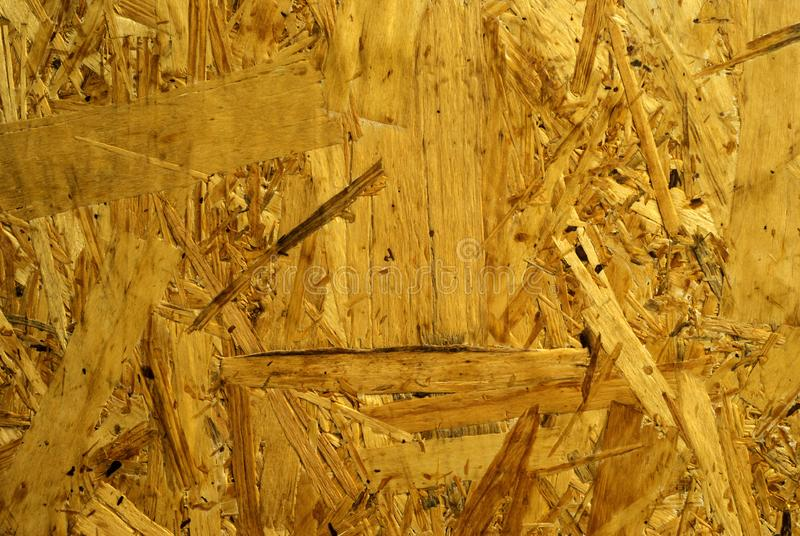 Background, texture - chipboard. Background, texture - surface of rough chipboard close-up stock photography