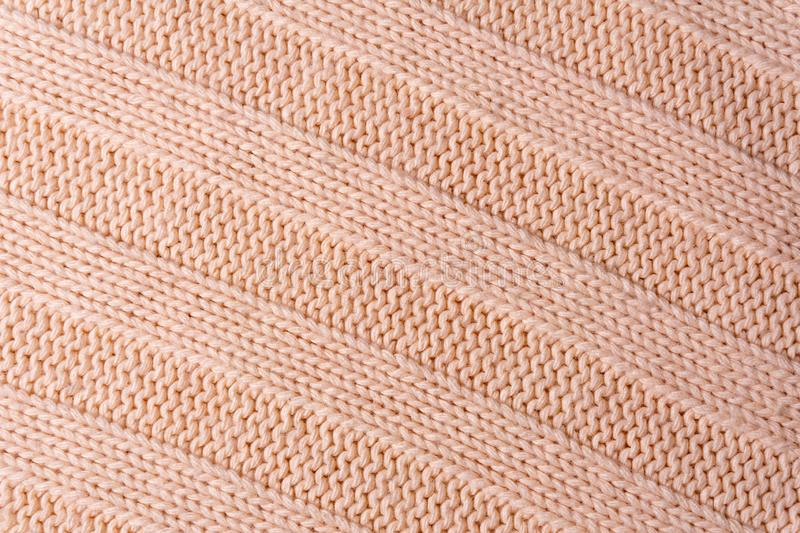 Background, texture - surface of a wool knitted fabric close up royalty free stock photo