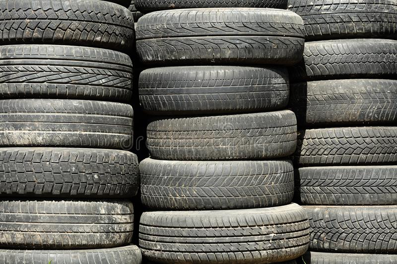 Background texture of used, dirty car tyre stacks royalty free stock photo