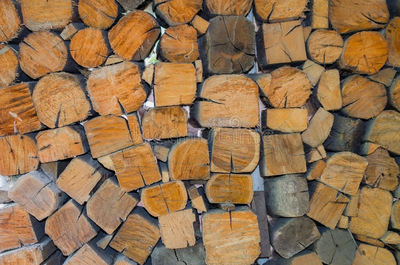 Background, texture of the wall from the folded logs royalty free stock images